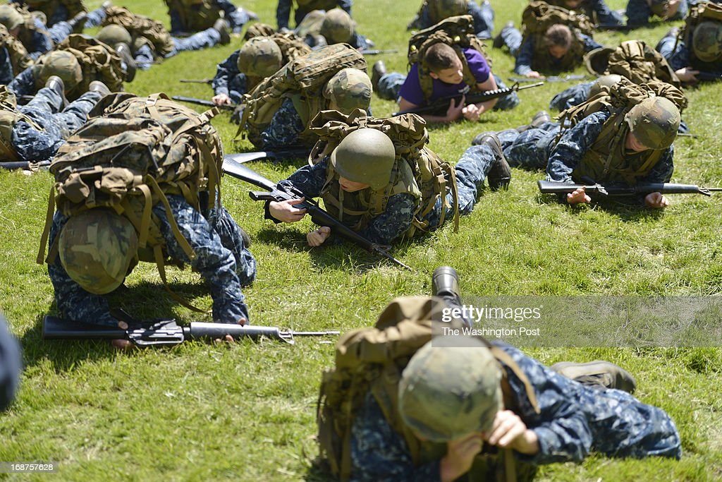 """MAY 14 Midshipmen crawl through makeshift trenches during their sea trials at the United States Naval Academy in Annapolis, Maryland on May 14, 2013. Sea Trials is modeled after the Marine Corps' Crucible and the Navy's Battle Stations recruit programs. It is a """"capstone"""" event for the fourth class midshipmen (freshmen or """"plebes"""") and serves as a leadership challenge for the upper class. Sea Trials is led by academy upper class and provides a final physical and mental challenge to the plebes, designed to test their teamwork and to reinforce their bonds as a company and class. Plebes are physically and mentally tested through a variety of challenges in different stations located across the Academy and Naval Support Activity Annapolis. At the end of Sea Trials, the company of plebes who demonstrated the top unit performance through endurance and spirit during the entire course will be recognized with the """"Iron Company"""" award during a brief presentation."""