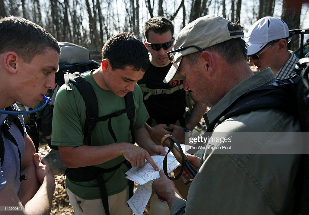 Shenandoah National Park, VA - March 14, 2012: Midshipmen, from left, Dan Wright, Kieran Simonson, and Joseph Livi check a map with trip leaders, retired Lt. Col. USMC Eric Carlson, fourth from right, and Captain James Smith, far right while hiking on the Appalachian Trail, Wed. March 14, 2012. The group from the U.S. Naval Acadamy took part in a five day leadership course hiking the Appalachian Trail and learning about Stonewall Jackson's Valley Campaign during the Civil War.