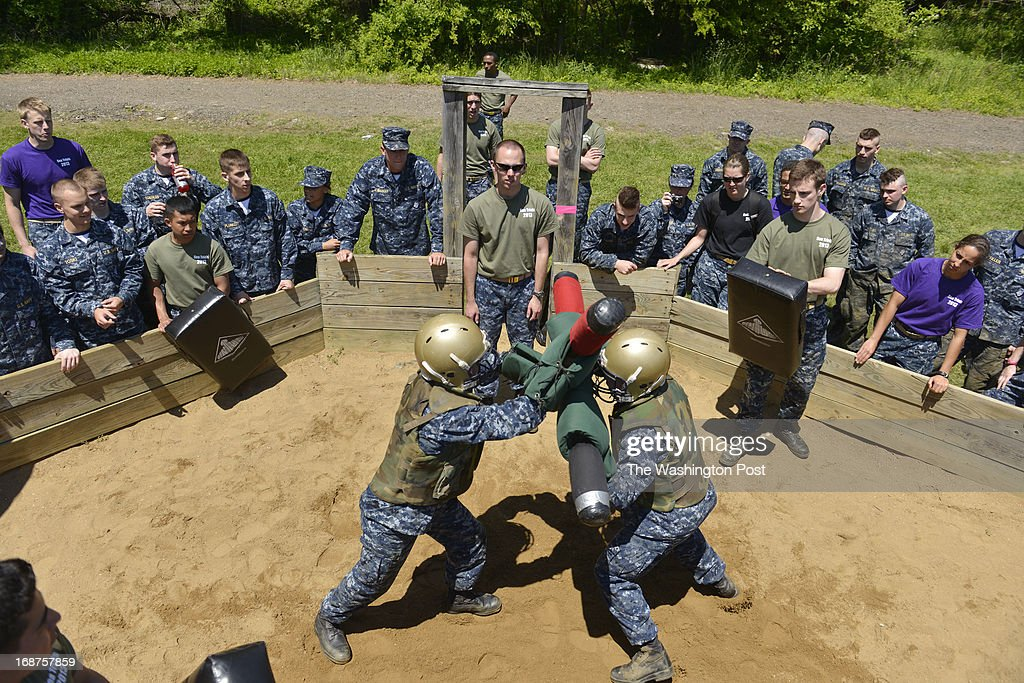 """MAY 14 Midshipmen pelt each other with pugil sticks at this particular station during the sea trials at the United States Naval Academy in Annapolis, Maryland on May 14, 2013. Sea Trials is modeled after the Marine Corps' Crucible and the Navy's Battle Stations recruit programs. It is a """"capstone"""" event for the fourth class midshipmen (freshmen or """"plebes"""") and serves as a leadership challenge for the upper class. Sea Trials is led by academy upper class and provides a final physical and mental challenge to the plebes, designed to test their teamwork and to reinforce their bonds as a company and class. Plebes are physically and mentally tested through a variety of challenges in different stations located across the Academy and Naval Support Activity Annapolis. At the end of Sea Trials, the company of plebes who demonstrated the top unit performance through endurance and spirit during the entire course will be recognized with the """"Iron Company"""" award during a brief presentation."""
