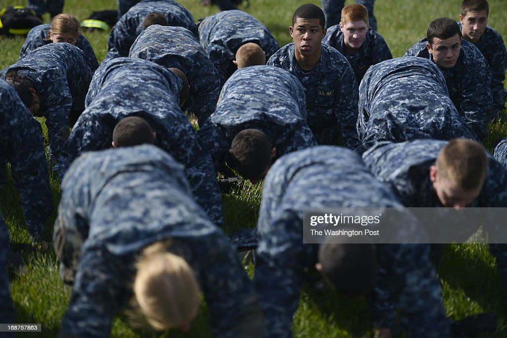 "MAY 14 Midshipmen performing push ups during the sea trials at the United States Naval Academy in Annapolis, Maryland on May 14, 2013. Sea Trials is modeled after the Marine Corps' Crucible and the Navy's Battle Stations recruit programs. It is a ""capstone"" event for the fourth class midshipmen (freshmen or ""plebes"") and serves as a leadership challenge for the upper class. Sea Trials is led by academy upper class and provides a final physical and mental challenge to the plebes, designed to test their teamwork and to reinforce their bonds as a company and class. Plebes are physically and mentally tested through a variety of challenges in different stations located across the Academy and Naval Support Activity Annapolis. At the end of Sea Trials, the company of plebes who demonstrated the top unit performance through endurance and spirit during the entire course will be recognized with the ""Iron Company"" award during a brief presentation."