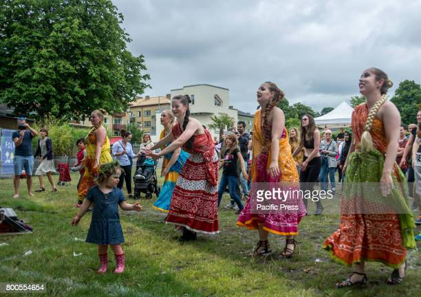 Midsummer celebration with traditional Swedish dances but also Bollywood music and dance in Folkets Park Malmö a city with a culturally mixed...