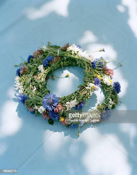 Midsummer wreaths on a table.