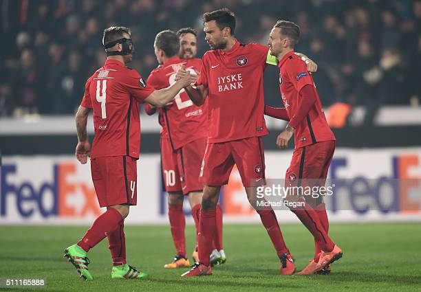 Midtjylland players celebrate their 21 win in the UEFA Europa League round of 32 first leg match between FC Midtjylland and Manchester United at...