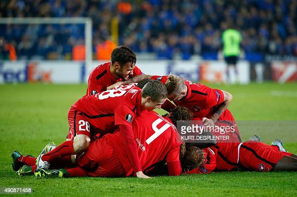 Midtjylland's defender Filip Novak celebrates with his teammates after scoring during the UEFA Europa League group D football match between Club...