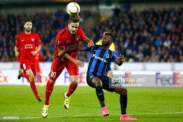 Midtjylland's defender Filip Novak vies for the ball with Club's Abdoulay Diaby during the UEFA Europa League group D football match between Club...