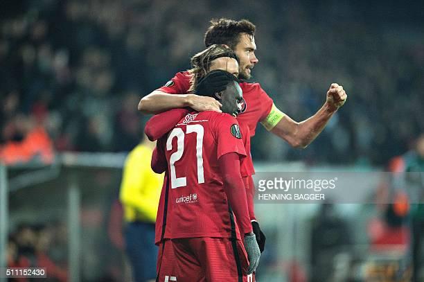 FC Midtjylland's forward Pione Sisto celebrates scoring the 11 goal with his teammates during the UEFA Europa League Round of 32 football match...