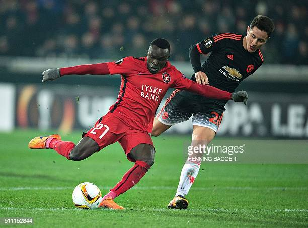 FC Midtjylland's forward Pione Sisto scores the 11 goal past Manchester United's Spanish midfielder Ander Herrera during the UEFA Europa League Round...