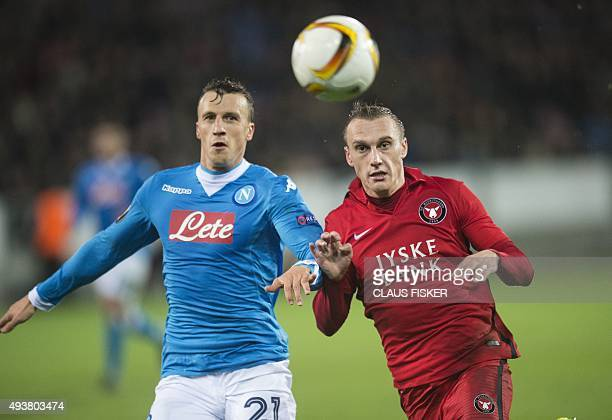 Midtjylland's Martin Pusic vies for the ball with Napoli's Vlad Chiriches during the UEFA Europa League Group D football match FC Midtjylland vs SSC...