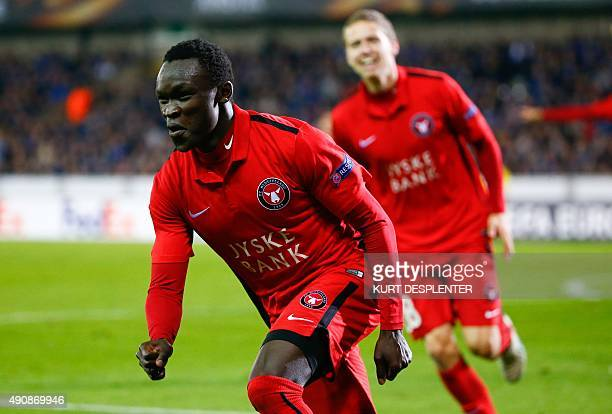 Midtjylland's midfielder Pione Sisto celebrates after scoring during the UEFA Europa League group D football match between Club Brugge KV and FC...