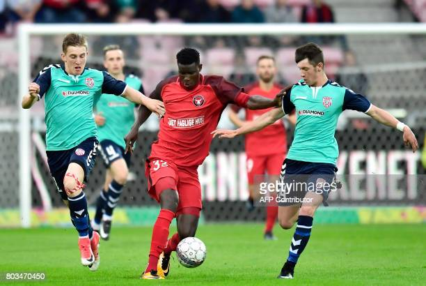 FC Midtjylland's Paul Onuacho vies for the ball with Rory Holden and Nicky Low from Derry City during their UEFA Europa League qualifying match on...