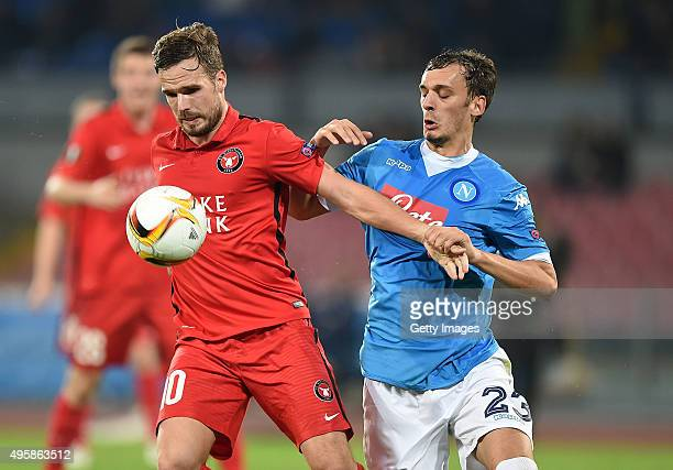 Midtjylland's player Filip Novak vies with SSC Napoli player Manolo Gabbiadini during the UEFA Europa League Group D match between SSC Napoli and FC...