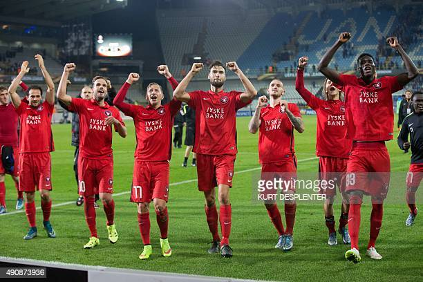 Midtjylland's players celebrate after winning the UEFA Europa League group D football match against Club Brugge on October 1 2015 in Brugge AFP PHOTO...