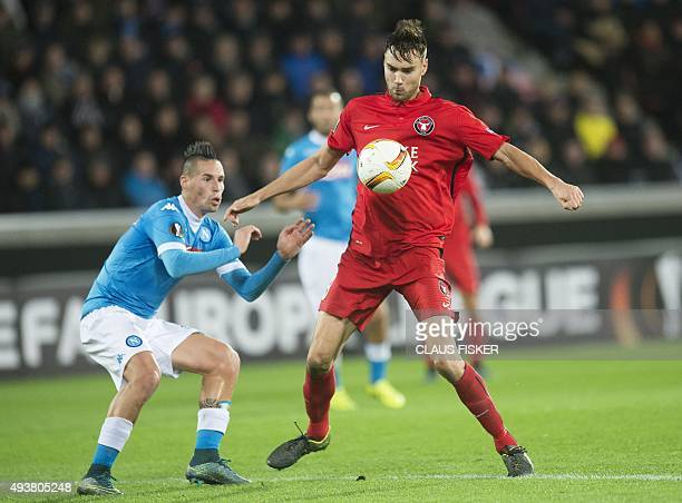 Midtjylland's Tim Sparv vies for the ball with Napoli's Marek Hamsik during the UEFA Europa League Group D football match FC Midtjylland vs SSC...