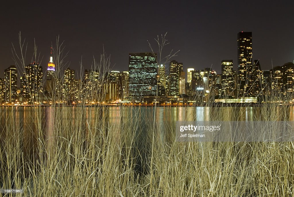 Midtown Manhattan skyline and East River at night : Stock Photo