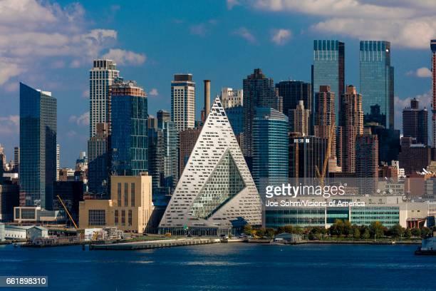 Midtown Skyline of Manhattan New York shows VIA 57 West at 625 West 57th St in Hells Kitchen Pyramid and Hudson River architecture by Bjarke Ingelss...