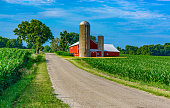 Midwest farm with country road and red barn (P)