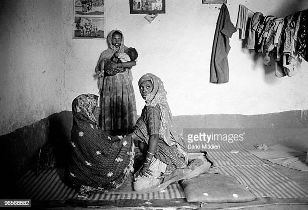 A midwife attending a pregnant woman at her home in a small village near Addis Ababa the capital of Ethiopia in 1998