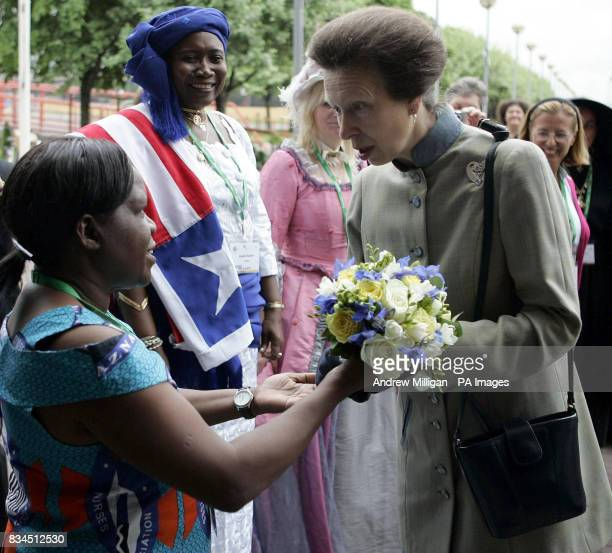 Midwife Dorcas Phiri from Zambia hands flowers to the Princess Royal as she arrives at the 28th International Congress of Midwives in Glasgow