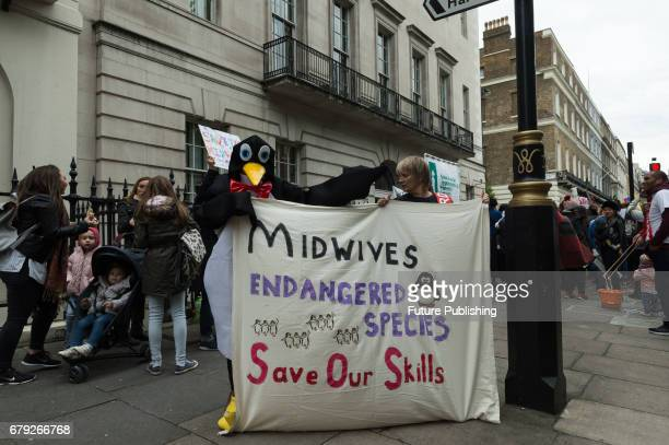 Midwives nurses and parents gather outside the Nursing and Midwifery Council in London to protest against council's lack of protection and incorrect...