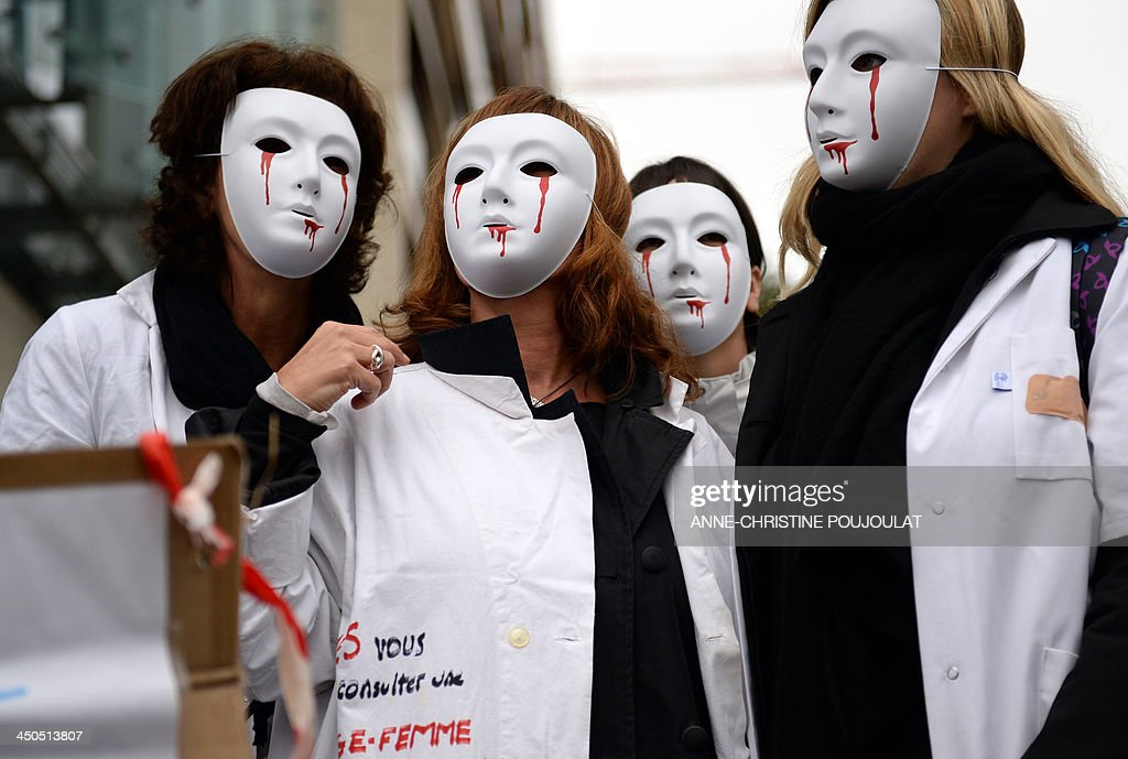 Midwives protest on November 19, 2013 in front of the Regional Health Agency (ARS) in the southern French city of Marseille as part of a nationwide strike during the opening of talks at the Health Ministry in Paris to discuss their status and their mission.