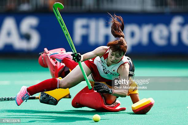 Mie Nakashima of Japan and Aisling D'hooghe of Belgium battle for the ball in the penalty shoot out for the 5th to 8th place match between Belgium...