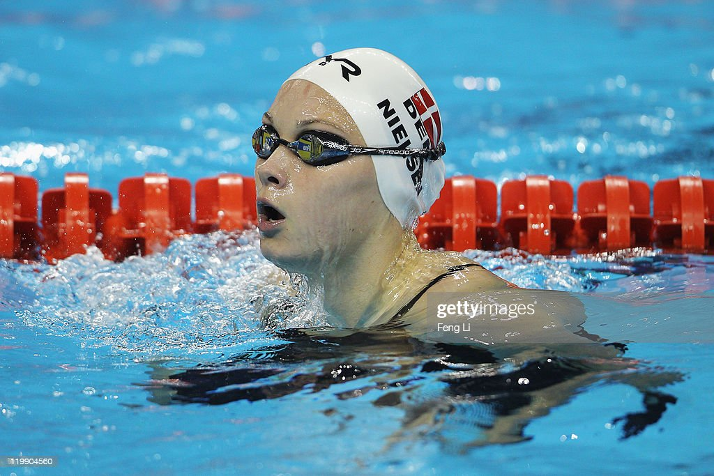 <a gi-track='captionPersonalityLinkClicked' href=/galleries/search?phrase=Mie+Nielsen&family=editorial&specificpeople=3000359 ng-click='$event.stopPropagation()'>Mie Nielsen</a> of Denmark competes in heat three of the Women's 50m Backstroke heats during Day Twelve of the 14th FINA World Championships at the Oriental Sports Center on July 27, 2011 in Shanghai, China.