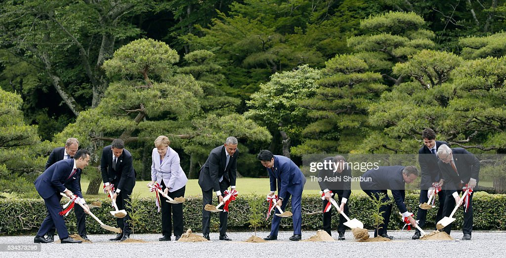 Mie Prefecture Govorner Eikei Suzuki, European Council President <a gi-track='captionPersonalityLinkClicked' href=/galleries/search?phrase=Donald+Tusk&family=editorial&specificpeople=870281 ng-click='$event.stopPropagation()'>Donald Tusk</a>, Italian Prime Minister <a gi-track='captionPersonalityLinkClicked' href=/galleries/search?phrase=Matteo+Renzi&family=editorial&specificpeople=6689301 ng-click='$event.stopPropagation()'>Matteo Renzi</a>, German Chancellor <a gi-track='captionPersonalityLinkClicked' href=/galleries/search?phrase=Angela+Merkel&family=editorial&specificpeople=202161 ng-click='$event.stopPropagation()'>Angela Merkel</a>, U.S. President <a gi-track='captionPersonalityLinkClicked' href=/galleries/search?phrase=Barack+Obama&family=editorial&specificpeople=203260 ng-click='$event.stopPropagation()'>Barack Obama</a>, Japanese Prime Minister <a gi-track='captionPersonalityLinkClicked' href=/galleries/search?phrase=Shinzo+Abe&family=editorial&specificpeople=559017 ng-click='$event.stopPropagation()'>Shinzo Abe</a>, French President Francois Hollande, British Prime Minister <a gi-track='captionPersonalityLinkClicked' href=/galleries/search?phrase=David+Cameron+-+Politiker&family=editorial&specificpeople=227076 ng-click='$event.stopPropagation()'>David Cameron</a>, Canadian Prime Minister <a gi-track='captionPersonalityLinkClicked' href=/galleries/search?phrase=Justin+Trudeau&family=editorial&specificpeople=2616495 ng-click='$event.stopPropagation()'>Justin Trudeau</a> and European Commission President <a gi-track='captionPersonalityLinkClicked' href=/galleries/search?phrase=Jean-Claude+Juncker&family=editorial&specificpeople=207032 ng-click='$event.stopPropagation()'>Jean-Claude Juncker</a> attend a tree planting ceremony ahead of the Group of Seven summit at Ise Shrine on May 25, 2016 in Ise, Mie, Japan. The 2-day Group of Seven summit takes place to discuss key global issues such as global economy and counter terrorism measures.