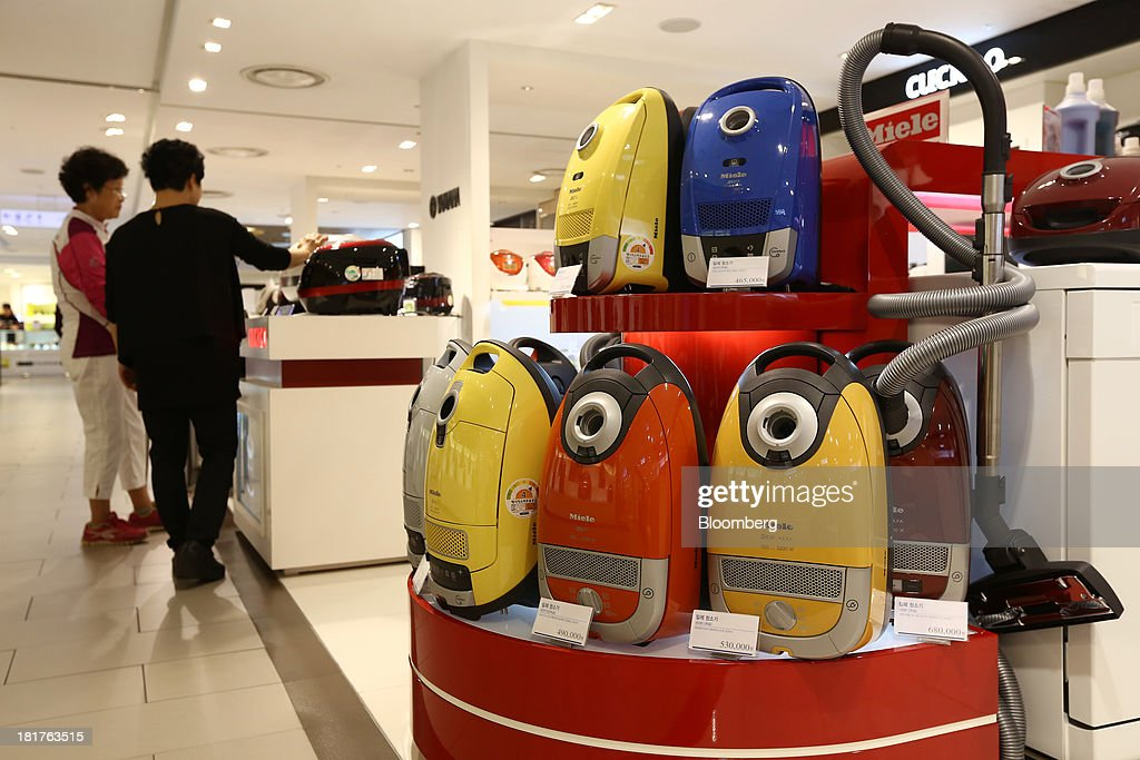 Miele & Cie KG vacuum cleaners are displayed at a Shinsegae Co. department store in Seoul, South Korea, on Tuesday, Sept. 24, 2013. The South Korean economy faces headwinds, with record household debt and a sluggish housing market weighing on consumption. Photographer: SeongJoon Cho/Bloomberg via Getty Images
