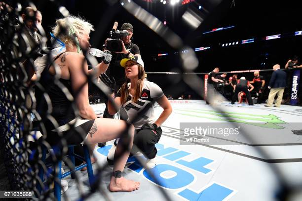 Miesha Tate corners Cindy Dandois between rounds against Alexis Davis in their women's bantamweight bout during the UFC Fight Night event at...