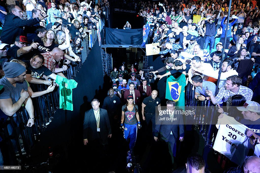 Miesha Tate enters the arena prior to her bout against UFC Women's Bantamweight Champion Ronda Rousey during the UFC 168 event at the MGM Grand Garden Arena on December 28, 2013 in Las Vegas, Nevada.