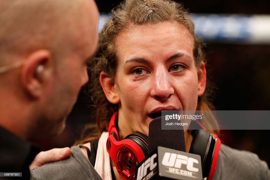 Miesha Tate is interviewed after her loss to Ronda Rousey in their UFC women's bantamweight championship bout during the UFC 168 event at the MGM Grand Garden Arena on December 28, 2013 in Las Vegas, Nevada.