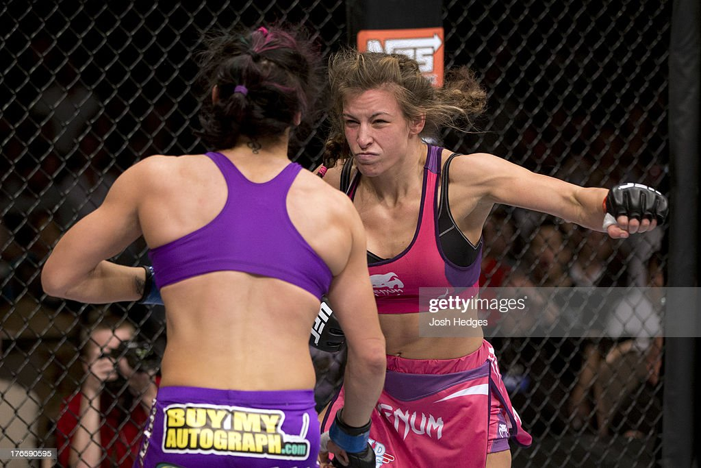 <a gi-track='captionPersonalityLinkClicked' href=/galleries/search?phrase=Miesha+Tate&family=editorial&specificpeople=7140028 ng-click='$event.stopPropagation()'>Miesha Tate</a> punches Cat Zingano in their bantamweight fight at the Mandalay Bay Events Center on April 13, 2013 in Las Vegas, Nevada.