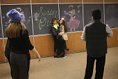 Miffie Fierro poses for photos with a high school student at the 'Senior Citizens Senior Prom' on April 2 2015 in the Staten Island borough of New...