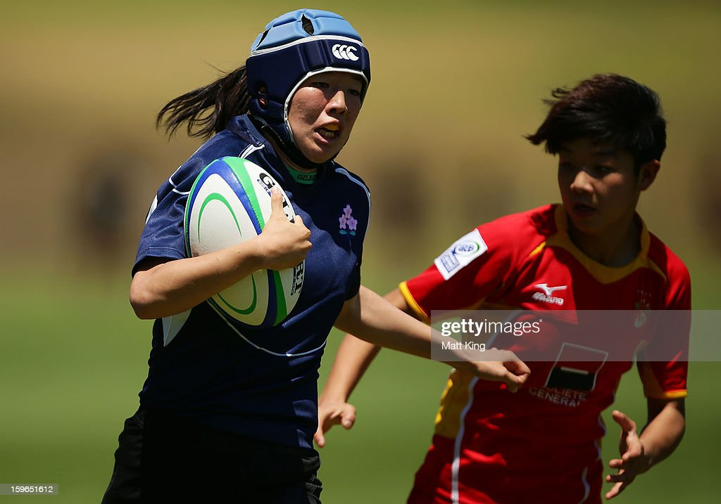Mifuyu Koide of Japan makes a break in the Women's Rugby Sevens during day three of the Australian Youth Olympic Festival at St Ignatius College on January 18, 2013 in Sydney, Australia.