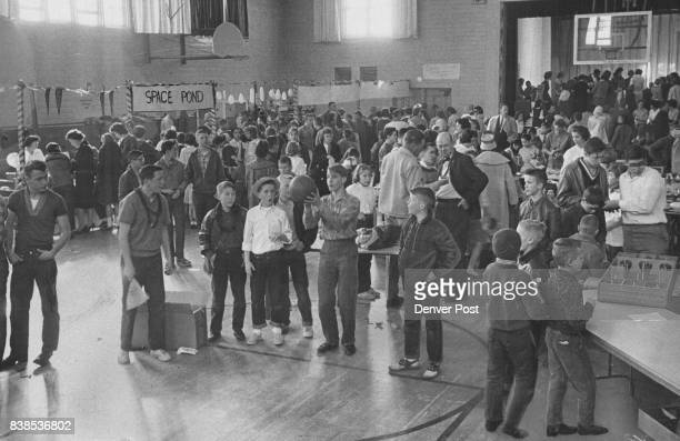 Mighty Crowded for a Basketball game Blessed Sacrament gym in East Denver is designed for basketball but not under these conditions Boys at left are...
