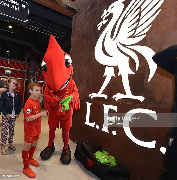 Mighty Red mascot of Liverpool with fans at the main stand test event at Anfield on August 29 2016 in Liverpool England