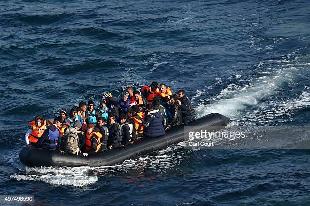 A migrant boat makes the crossing from Turkey to the Greek island of Lesbos on November 17 2015 in Sikaminias Greece Rafts and boats continue to make...