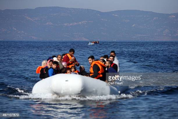 Migrant boats make the crossing from Turkey to the Greek island of Lesbos on November 14 2015 in Sikaminias Greece Rafts and boats continue to make...