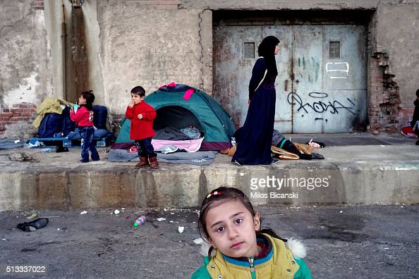 A migrant child outside a passenger terminal where migrants have found shelter at the port of Piraeus on March 2 2016 in Athens Greece Border...