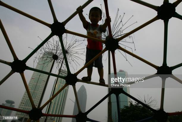 A migrant child plays at a construction site on June 22 2007 in Wuhan of Hubei Province China Research shows that from 2003 to 2006 the average...