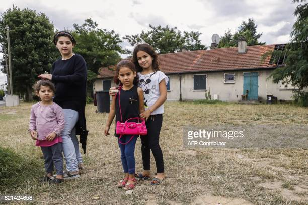 Migrant children from a family of migrants threatened of eviction are pictured on July 20 2017 outside a house they live in since 2015 at the former...
