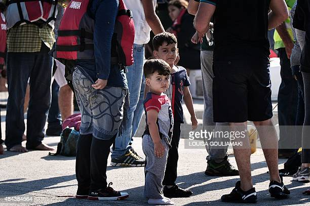 Migrant children stand at the port of Kos after greek coast guard intercepted them at sea between Greece and Turkey near Kos island on August 18 2015...