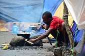 A migrant cooks in an encampment of Africans in Penas Blancas Guanacaste Costa Rica in the border with Nicaragua on July 19 2016 In a makeshift camp...