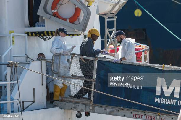 A migrant during the phase of landing migrants from Phoenix MOAS ship in the port of Crotone Calabria southern Italy 600 refugees landed from Phoenix...