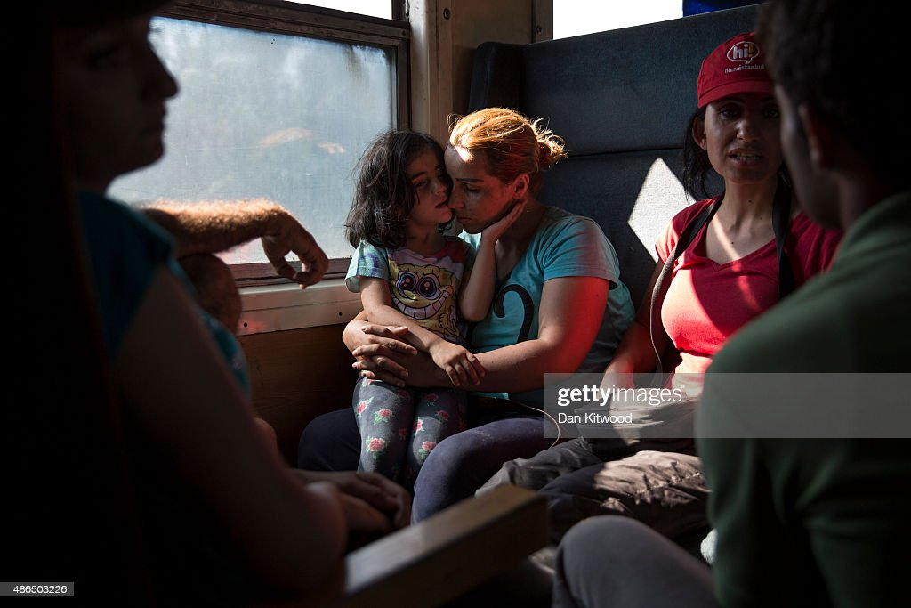 Migrant families ride a train from Gevgelija in Macedonia to the Serbian border on September 4, 2015 in Macedonia. After stopping at a Serbian processing facility for migrants only, most people will continue on foot for the next 6 miles into the Serbian town of Preshevo. Since the beginning of 2015 the number of migrants using the so-called 'Balkans route' has exploded with migrants arriving in Greece from Turkey and then travelling on through Macedonia and Serbia before entering the EU via Hungary. The number of people leaving their homes in war torn countries such as Syria, marks the largest migration of people since World War II.