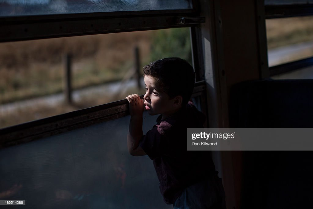 Migrant families ride a train from Gevgelija to the Serbian border on September 4, 2015 in Macedonia. After stopping at a Serbian processing facility for migrants only, most people will continue on foot for the next 6 miles into the Serbian town of Preshevo. Since the beginning of 2015 the number of migrants using the so-called 'Balkans route' has exploded with migrants arriving in Greece from Turkey and then travelling on through Macedonia and Serbia before entering the EU via Hungary. The number of people leaving their homes in war torn countries such as Syria, marks the largest migration of people since World War II.