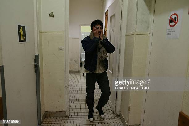 A migrant from Afghanistan is pictured in the premises of a former church where sixty migrants hoping to take a ferry from Cherbourg to Portsmouth in...