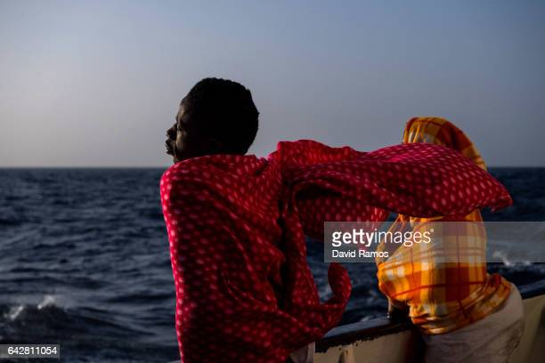 A migrant from Togo is seen on deck of the Spanish NGO Proactiva Open Arms rescue vessel Golfo Azzurro sailing towards the Italian port of Pozzallo...