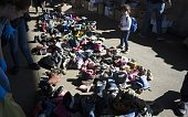 A migrant girl looks at donated clothing and shoes at the former truck custom station near the Austrian side of the border between Hungary and...