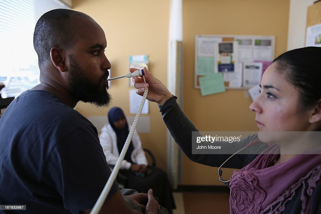 Migrant health director Miriam Ceja de Dias takes the temperature of a Somali asylum immigrant at the Salud Family Health Clinic on May 2, 2013 in Fort Collins, Colorado. The non-profit clinic provides health services to asylum immigrants as well as mobile care to migrant farm workers, many of whom have no other access to healthcare, throughout northeastern Colorado. Immigrant access to healthcare has become a major issue in current immigration reform proposals.